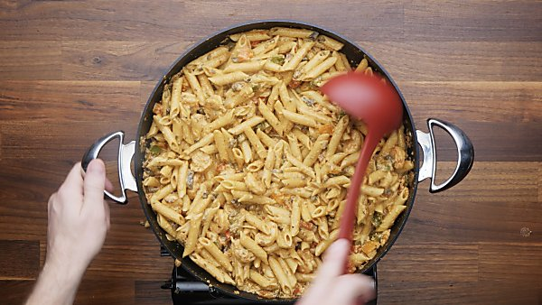 finished cajun shrimp pasta in skillet