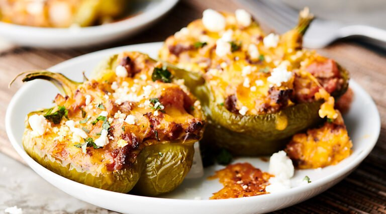 cheesy stuffed peppers on plate