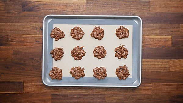 crockpot candy portioned out on baking sheet