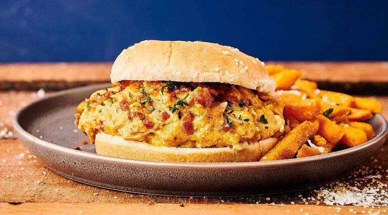 crockpot crack chicken sandwich on plate with fries
