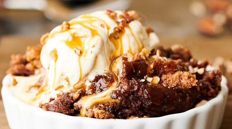 bowl with crockpot pumpkin dump cake and ice cream