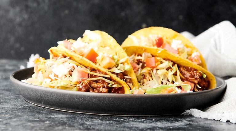 crockpot taco meat tacos on plate