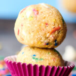 two balls of funfetti edible cookie dough stacked