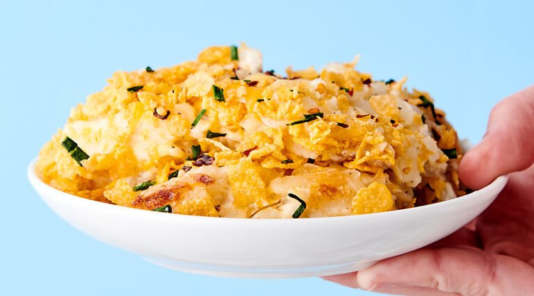hashbrown casserole on plate held