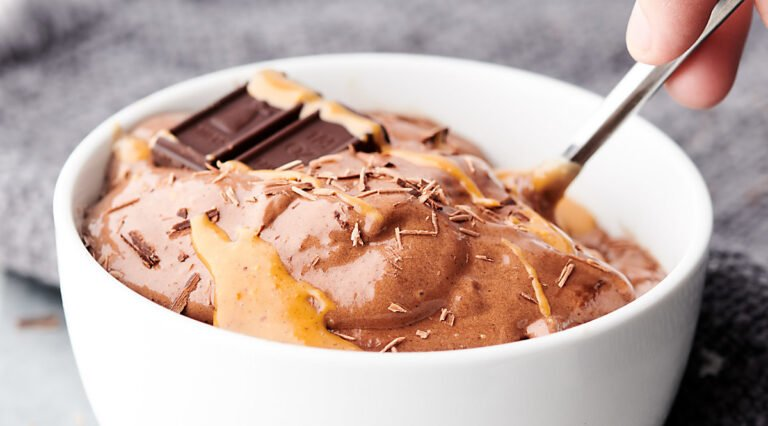 bowl of healthy chocolate peanut butter banana ice cream