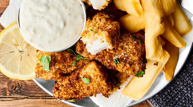homemade healthy air fryer fish sticks on plate above
