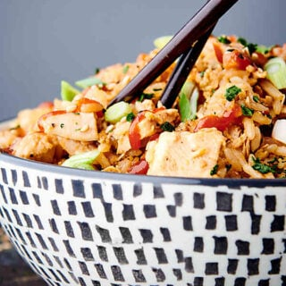 chopsticks in bowl of instant pot chicken fried rice