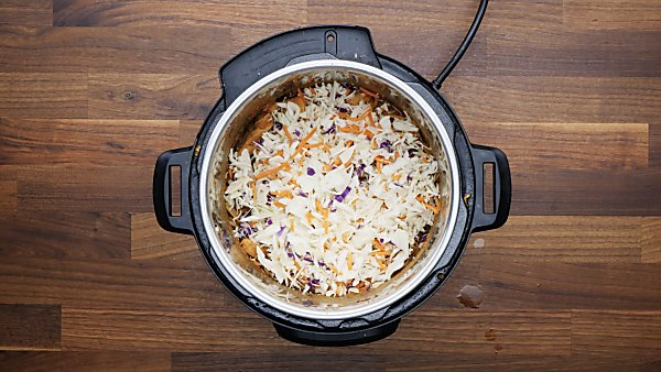 noodles and cole slaw mix added to sauce