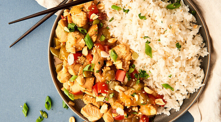 kung pao chicken with rice on plate above