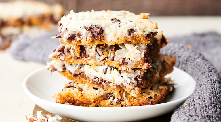 magic cookie bars stacked on plate