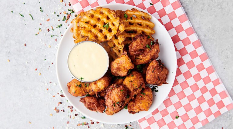 popcorn chicken on plate with fries above