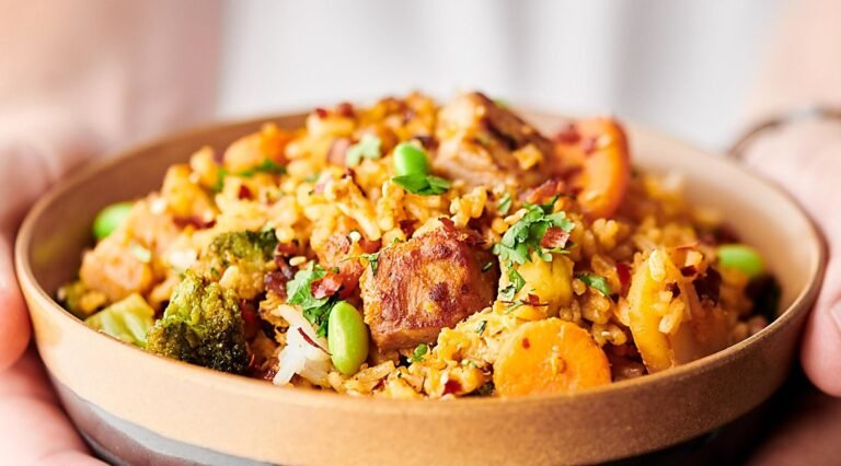bowl of pork fried rice held