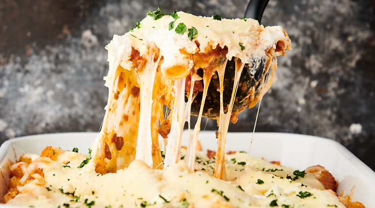 rigatoni being scooped with ladle