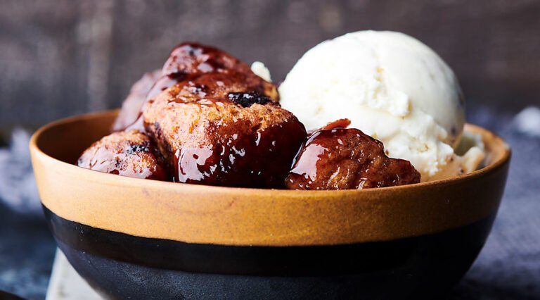 bowl of slow cooker cherry cobbler with scoop of ice cream