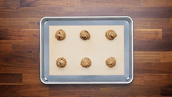 cookie dough balls on baking sheet