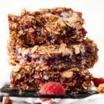 three vegan raspberry oatmeal bars stacked