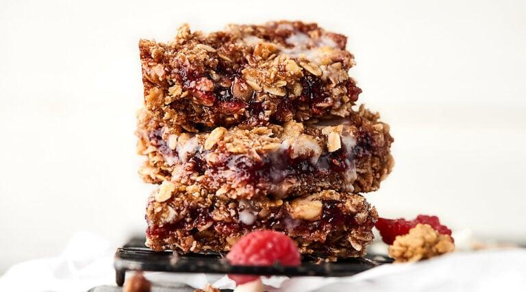 three vegan raspberry oatmeal bars stacked