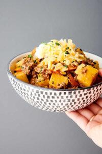 bowl of poor man's stew held one hand