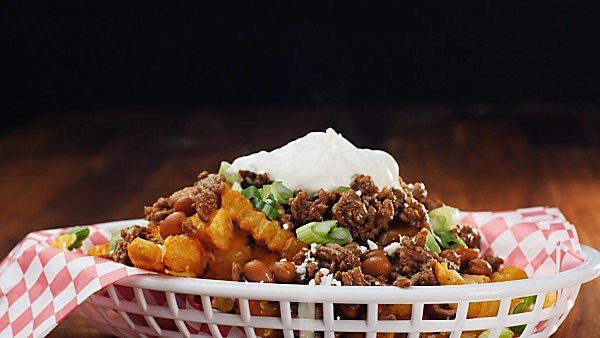 air fryer frozen french fries being served as chili cheese fries