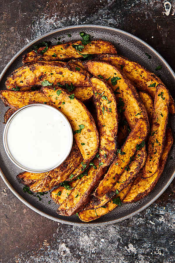 plate of air fryer potato wedges above