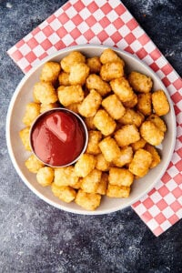 plate of air fryer tater tots with ketchup above