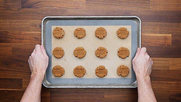 unbaked almond flour peanut butter cookies on baking sheet