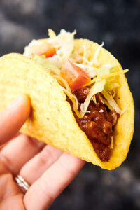 taco made with crockpot taco meat held