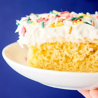 slice of cake on plate held