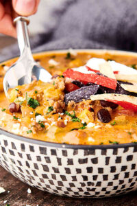 bowl of instant pot taco soup with spoon dipped in side view