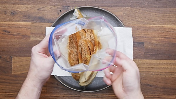 seasonings coating potato wedges in ziplock bag