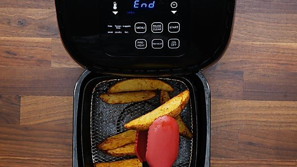 finished air fryer potato wedges in air fryer