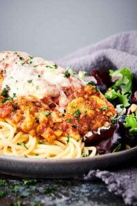 closeup of plate of crockpot chicken parmesan