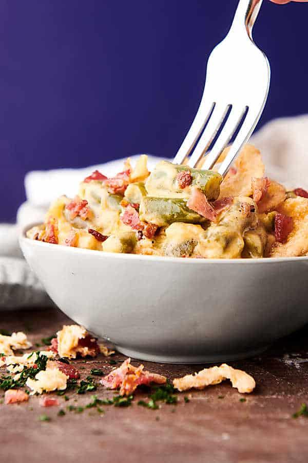 bowl of crockpot green bean casserole with fork