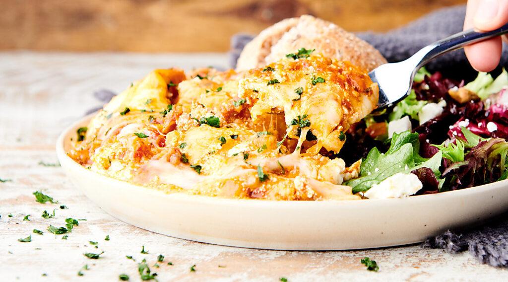 plate of crockpot lasagna with ravioli