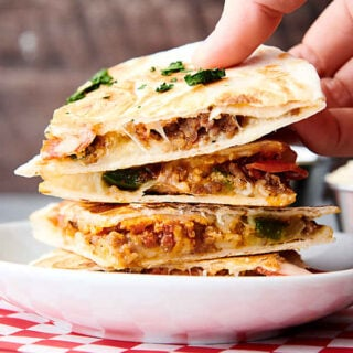 three slices of pizza quesadilla stacked