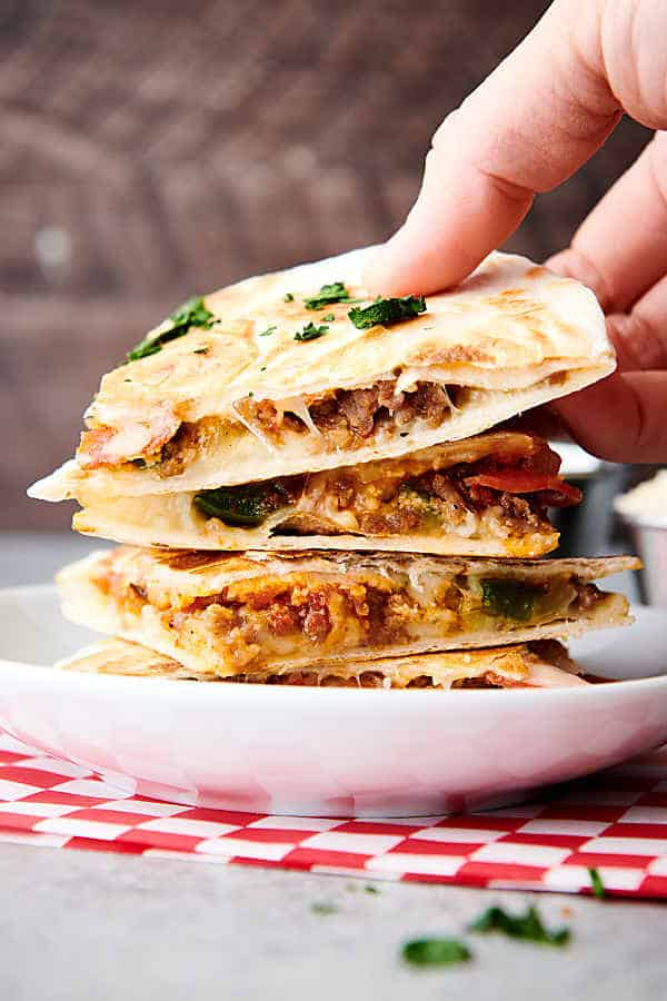 four slices of pizza quesadilla stacked