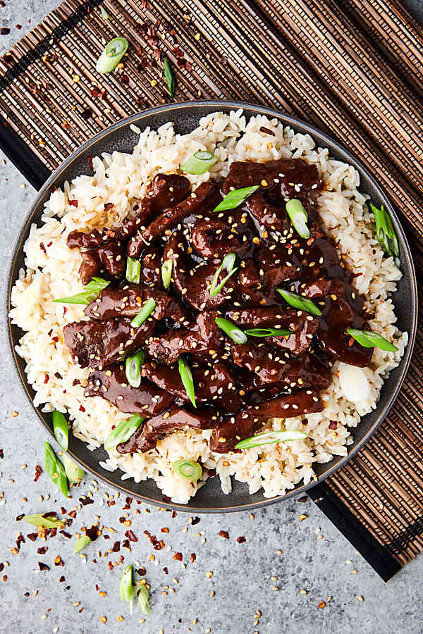 plate of slow cooker mongolian beef on plate above