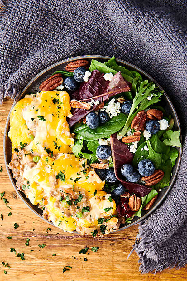 plate of instant pot shepherd's pie with salad above