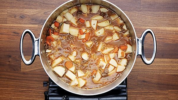 broth and potatoes added to stockpot