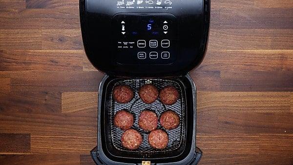 uncooked meatballs in air fryer