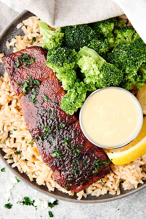air fryer salmon on plate over rice above