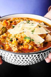 bowl of alphabet soup held