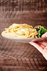 plate of cacio e pepe held