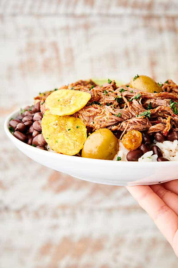 plate of instant pot ropa vieja held one hand