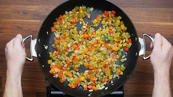 onions and peppers cooked in skillet