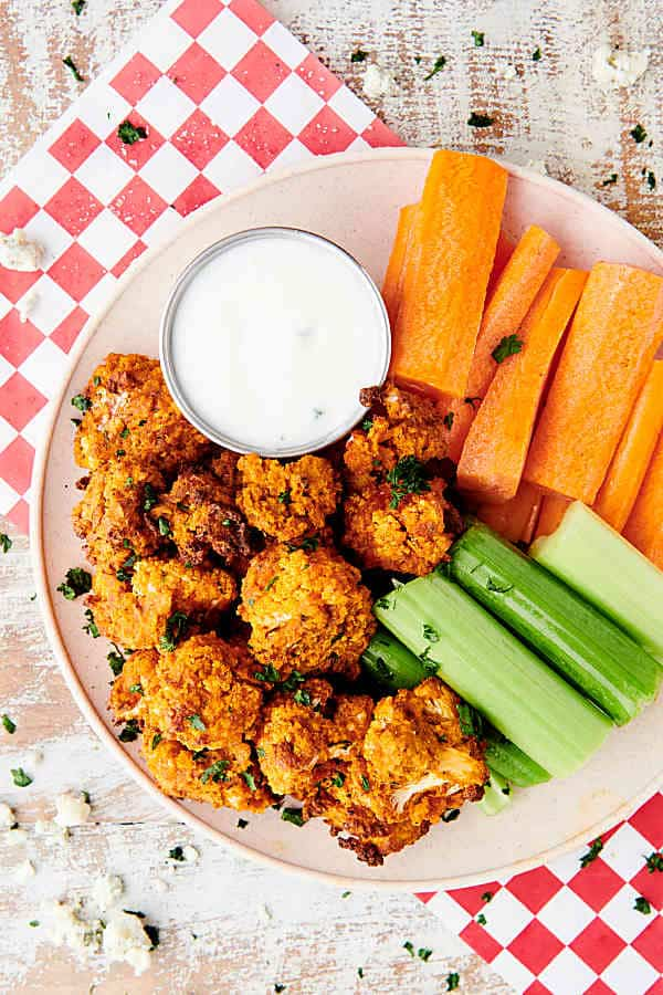 plate of air fryer buffalo cauliflower, celery, and carrots with ranch dressing