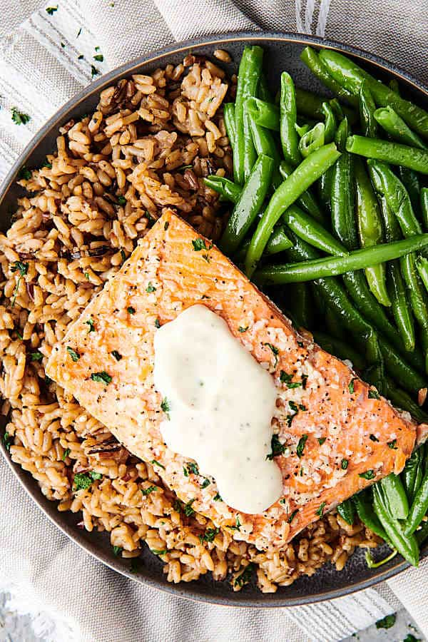 baked salmon on rice with green beans above
