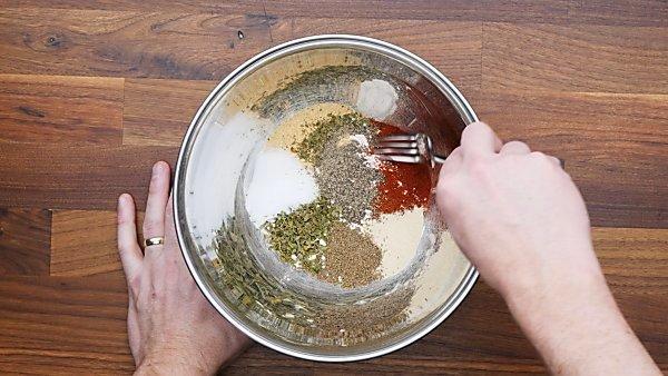 seasonings and flour in mixing bowl