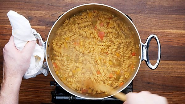 pasta and broth in stockpot