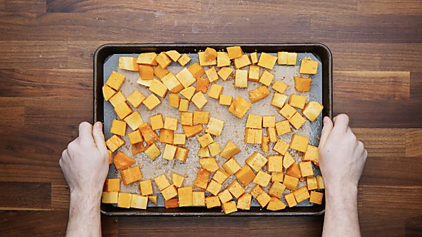 cubed squash on baking sheet